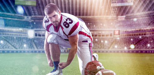 American Football Player on big modern stadium field