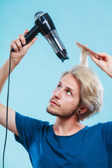 Trendy man with hair dryer