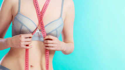 Woman in underwear with measure tape