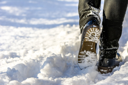 Woman walking in snow boots and jeans on legs, women's winter shoes