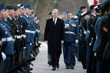 Belgium's King Philippe inspects the honour guard during an official welcome ceremony at Rideau Hall in Ottawa