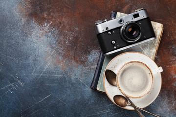 Coffee cup and retro camera