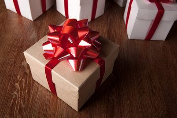One festive gift box with a red bow against a background of white boxes