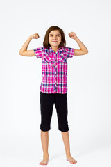 Young Girl Flexes With a Proud Smile on a White Background