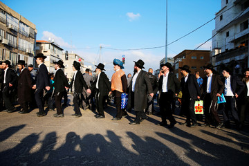 Israeli ultra-Orthodox Jewish men dance during a protest against the detention of a member of their community who refuses to serve in the Israeli army, in Bnei Brak