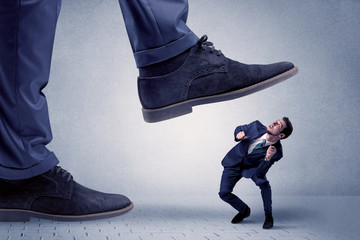 Young businessman getting crushed