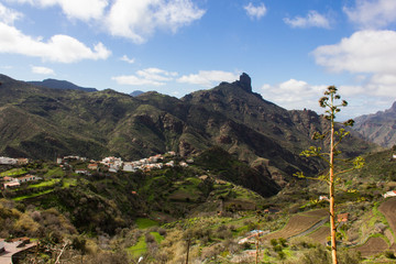 Great panoramic views of Roque Bentayga mountain from Tejeda town in Gran Canaria, Spain. Old town valley with iconic mountain on background on sunny day