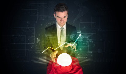 Businessman forecast the future of the stock market with a magic ball