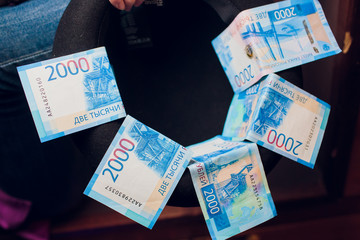 5 bills of new 2000 rubles lie in the hat