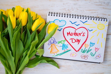 overhead view. mother day card with flowers on wooden background