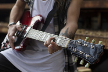 learn how to play on a guitar