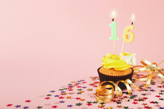 16th birthday cupcake with candle and sprinkles