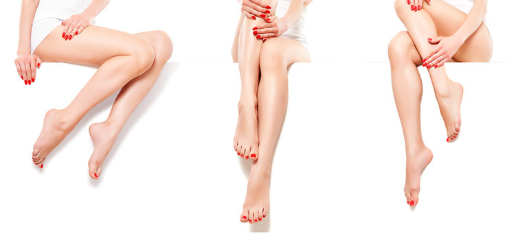 Three beautiful slim female legs with red manicure, isolated on white background