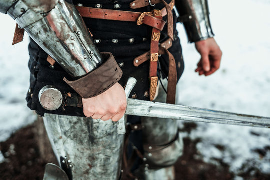 man's hand with an iron sword