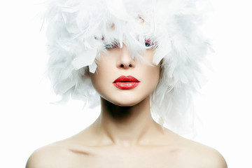 Beautiful Girl in white feathers Hat. Make-up Wall mural