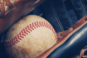 Baseball sport shown with ball in used leather glove.  Sports equipment for american game.