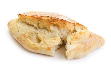 loaf of cracked ciabatta isolated on white background