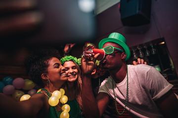 Friends making selfie and enjoying in nightclub