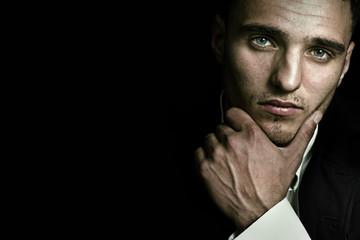 Dark face portrait of elegant masculine man