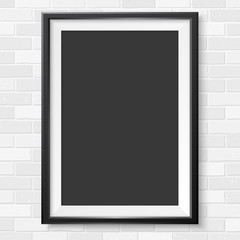 Photoframe realistic vertical mock up on brick wall black