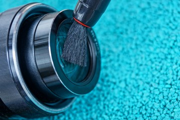 the brush clears the lens on a blue background