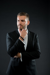 Manager in formal jacket, shirt on dark background, fashion