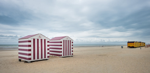 Row of colorful beach huts on a cloudy day