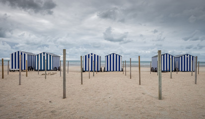 Row of colorful vintage beach huts