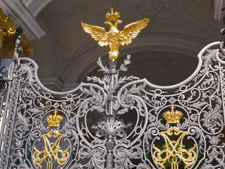 Details of the ornate old wrought iron gates of the State Hermitage Museum in Saint Petersburg