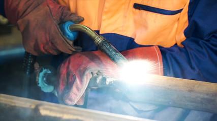 Welding with wire welding : Industrial welder, steel beam, light and sparks. Metal Welding Worker Welding Metal