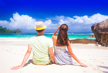 Young couple having fun at tropical Baie Lazare beach at Mahe island, Seychelles