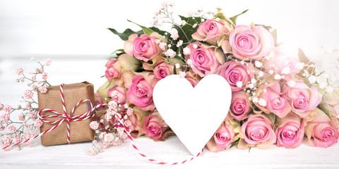 Mothers day gift with a heart and pink roses