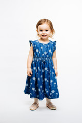 Full body portrait of a cute little preschool girl on white background