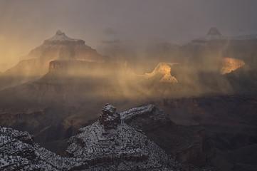 Snow showers over Grand Canyon at sunrise;  Arizona