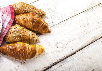 Croissants on white wooden background