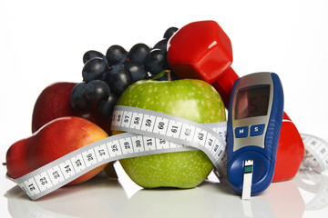 Diabetes monitor, cholesterol diet and healthy food eating nutritional concept with fresh fruits ,nutritionist's, table ,blood ,sugar, control, record ,diabetic ,measuring tool kit