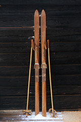 Photo of vintage old wooden skis on the terrace of a country house