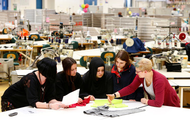 "Apprentices and their trainer are pictured in the sewing room of the Textile company ""TRIGEMA"" in Burladingen"
