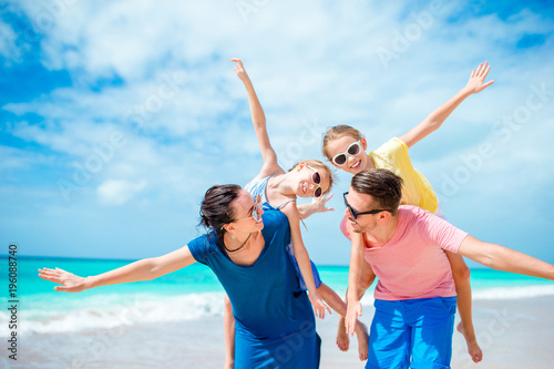 Happy family on beach vacation together