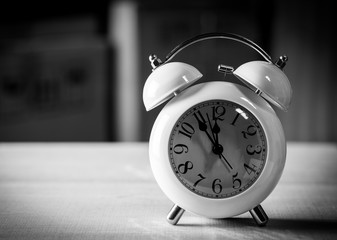 Alarm clock on the floor black and white picture style