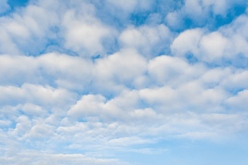 white clouds against blue sky, abstract background