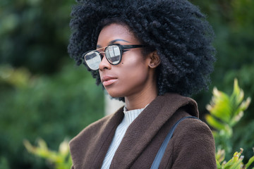 Beautiful African American Woman with black curly hair wearing sunglasses