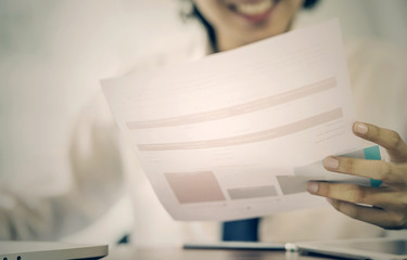 young businessman holding and looking at document paper