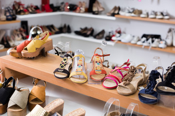 Elegant summer shoes are on the shelves in the store.