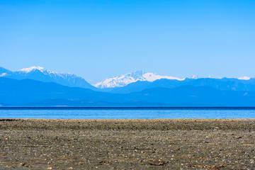 Rathtrevor Beach beach with Multi Layered of Mountain, British Columbia, Canada