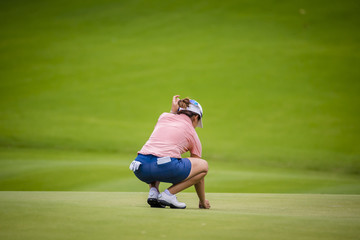 golfer checking line of fairway for teeing golf to hole on golf course