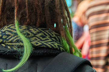 Dreadlocks with green tips of plaits closeup. Back view.
