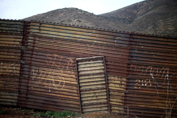A section of the fence separating Mexico and the United States is seen on the outskirts of Tijuana, Mexico