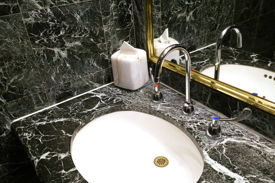 close up on ceramic sink with granite top in the bathroom