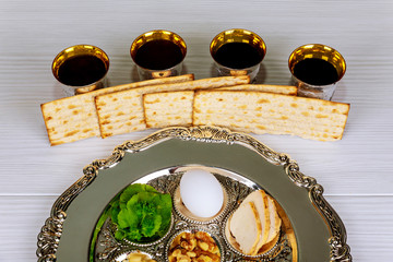 Pesah celebration Passover holiday. Traditional pesah plate text in hebrew: Passover, egg,
